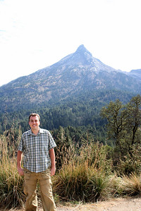 me on the volcano.. the peak is the old vent.  behind that is the active section of the volcano.