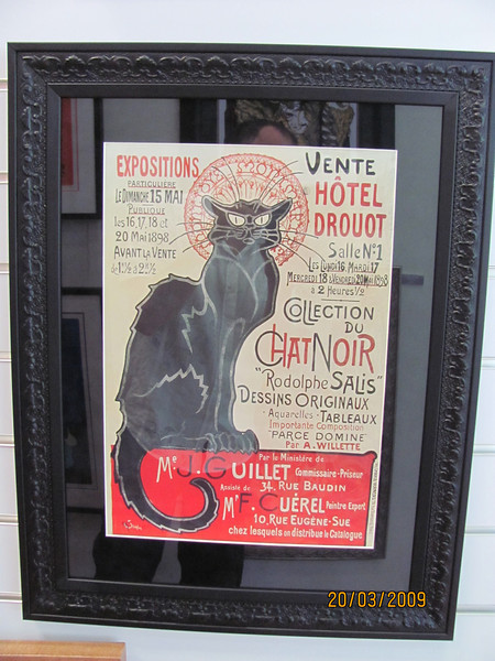 our favourite kitty, with black velvet surround and ornate black frame