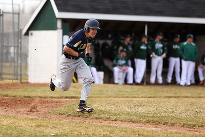 Ken Kadwell/@KenKadwell - Special to the Sun Shepherd's Casey Emmons sprints to first base at Clare Thursday, April 10, 2014.