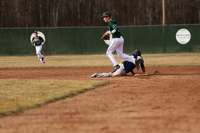 Ken Kadwell/@KenKadwell - Special to the Sun Clare's Camden Dice bounds off second base in an attempt for a double play after catching a line drive as Shepherds Nick Sponseller slides back to the base at Clare Thursday, April 10, 2014.  Sponseller was called safe.