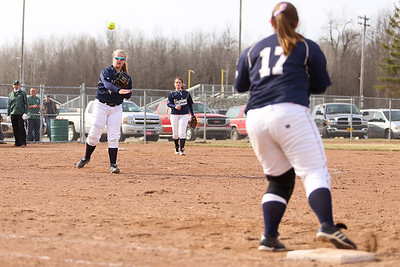 Ken Kadwell/@KenKadwell - Special to the Sun Shepherd's Charlie Bryant throws the ball to Katie McCullough (17) at first base tagging the runner out at Clare Thursday, April 10, 2014.