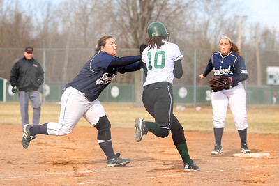 Ken Kadwell/@KenKadwell - Special to the Sun Shepherd's Katie McCullough tags Clare's Morgan English (10) out before reaching first base at Clare Thursday, April 10, 2014.