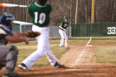 Ken Kadwell/@KenKadwell - Special to the Sun Clare's Logan Emery leads off third base as teammate Mason Pacard (10) bats against Shepherd at Clare Thursday, April 10, 2014.