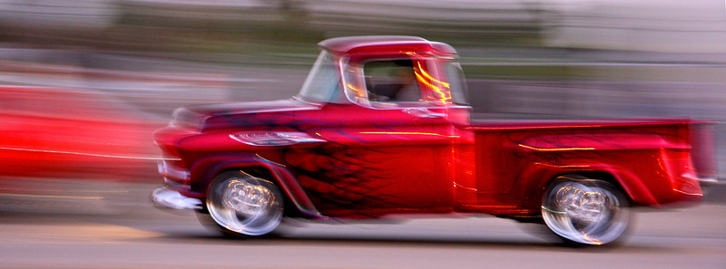 Red racer_ Classic Chevy pickup cruises through Arroyo Grande.
