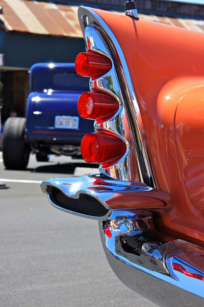 Fins to the left_ Chrome and roadsters on display at the Pismo Classic car show.