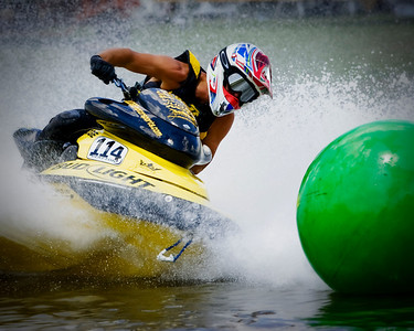 Local pro racer Claude Clayton rounds the equalizer bouy on his way to a first place finish in moto one of the 800 pro division Sunday at Veteran's park