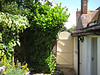 The neighbour put in a new gate. It looks good when you can see it - many thanks for John for cutting back the bush.