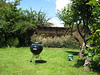 I think my barbeque looks good in the garden. The bucket of water was used for cleaning - I am perfectly safe with fire!