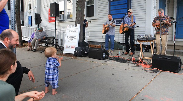 1st Saturday Downtown Plymouth will be a day to remember for Jeremy and Jamie of Sandwich, as ther 11mouth old son Jude took his first steps to the bluegrass music of The Wildcat Bogstomers. Wicked Local Photo/Denise Maccaferri