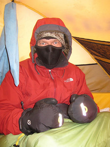 Trying to wam up inside the tent.: I must have gotten chilled on the last part of the climb through sleet and than snow.   I put all of my layers on and than crawled into my down sleeping bag to try warm up.  If I am this cold now what will tomorrow bring 4,400 feet higher?