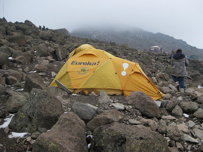 High camp at the end of day 4,  elevation 15,000 feet.: It is a lot more rugged here.   There is no vegetation at this location and it is quite cold this evening with prior sleet and snow.