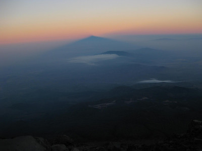 Shadow of Mt. Meru at sunrise as seen from near the summit