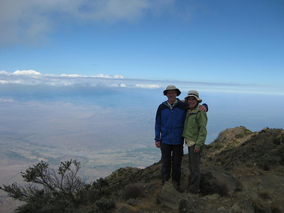 On top of Little Mt Meru with Mt. Kilimanjaro visible on the horizon
