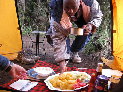 "This looked and tasted very good for ""trail food"": There was a very good soup in the pot he is holding.   There also was excellent deep fried fish to go with the potatoes and vegetables."