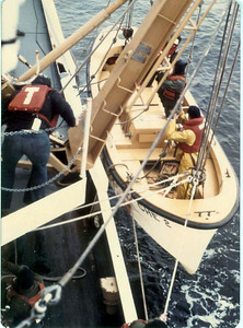 Lowering a small boat for a boarding.