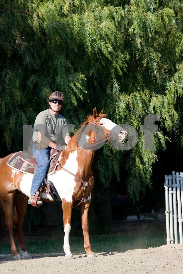 Cowboy Tom prepares for his ride.