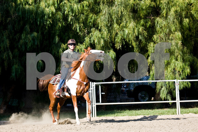 Cowboy Tom...and his paint horse..breaking out of the gate at a run, for the trail horse class.