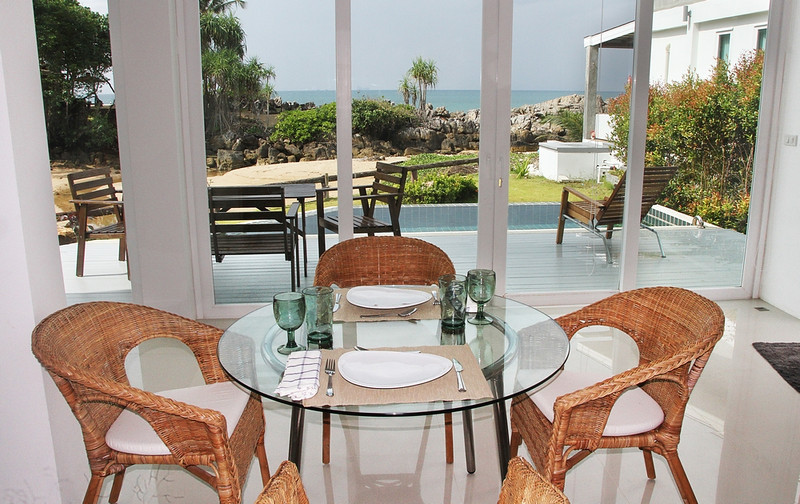 Dining area with dramatic pool and ocean views