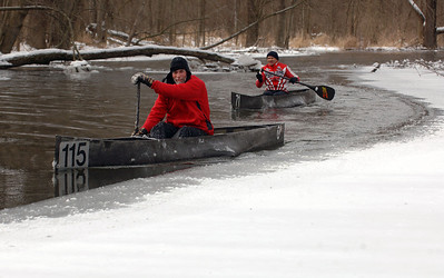 Bill Schmitz of Commerce Township, left, and Dan Klinkhammer of Northville maneuver their C-1 racing canoes around the ice on the Huron River, just downstream from the Island Lake Recreation Area near Brighton on Sunday, Feb. 4, 2007.  The high temperature for Sunday was in the single digits, with wind-chill temps well below zero.  (MARK BIALEK/Special to the Detroit News)