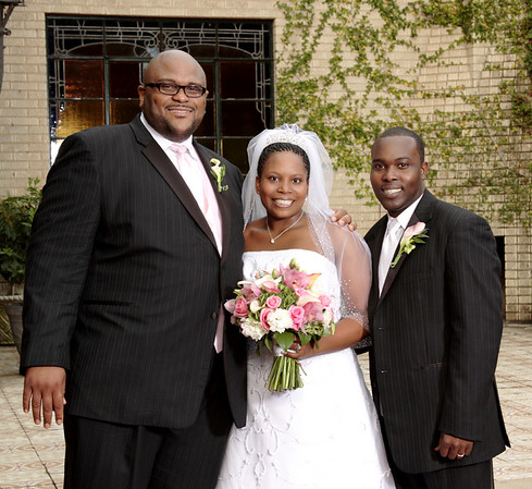 Julanda & Timothy George with god brother and American Idol celebrity Reuben Studdard.