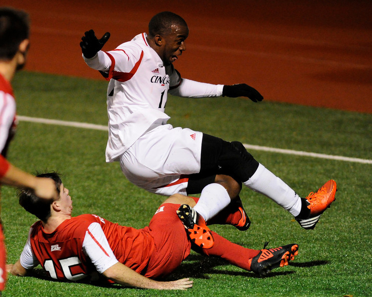 Cincinnati Bearcats (F) Leon Powell #12 and Rutgers Scarlet Knights (d/MF) Drew Morgan #15 during the game.  Cincinnati Bearcats defeat Rutgers Scarlet Knights (1-0) at Gettler Stadium in Cincinnati, Ohio.