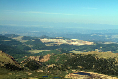 West view from the top of Pikes Peak.  Scarred area is a gold mine