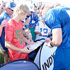 Don Knight/The Herald Bulletin<br /> Noticing a young boy upset and starting to cry line backer Pat Angerer offers him his hat to cheer him up following practice at Colts Camp on Tuesday.