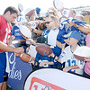 Don Knight/The Herald Bulletin<br /> Fans crowd the fence in hopes of getting quarterback Andrew Luck's autograph following practice at Colts Camp on Tuesday.