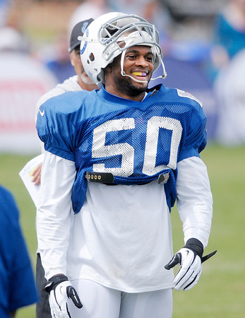 Don Knight/The Herald Bulletin<br /> Inside line backer Jerrell Freeman smiles during a break in the action during Colts Camp on Wednesday.