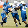 Don Knight/The Herald Bulletin<br /> Kerwynn Williams is blocked by Shawn Loiseau, left, and Ashante Williams during Colts Camp on Thursday.