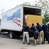 Don Knight/The Herald Bulletin<br /> Movers from Graebel Van Lines move the Colts out of the Kardatzke Wellness Center as Colts Camp came to a close on Friday.