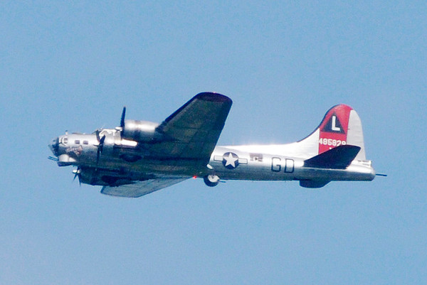 "Don Knight/The Herald Bulletin<br /> A B-17G Flying Fortress named ""Yankee Lady"" flies over Colts Camp on Friday."