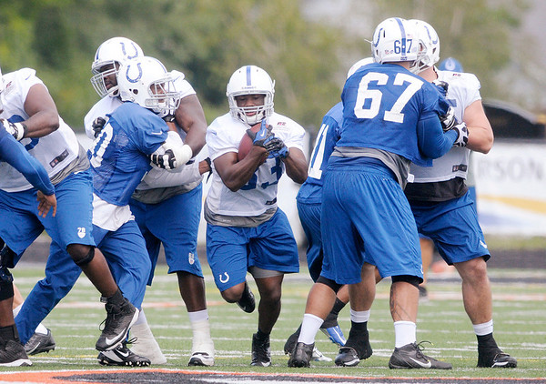 Don Knight/The Herald Bulletin<br /> Running back Vick Ballard carries the ball on a rushing play on the last day of Colts Camp on Friday.