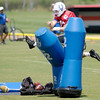 Don Knight/The Herald Bulletin<br /> Quarterback Andrew Luck leaps into the air and punches a tackling dummy as he runs to his next drill during Colts Camp on Friday.