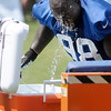 Don Knight/The Herald Bulletin<br /> Robert Mathis cools off with a dunk in a cooler.