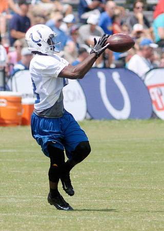 Don Knight/The Herald Bulletin<br /> Reggie Wayne catches the ball during practice at Colts Camp on Friday.