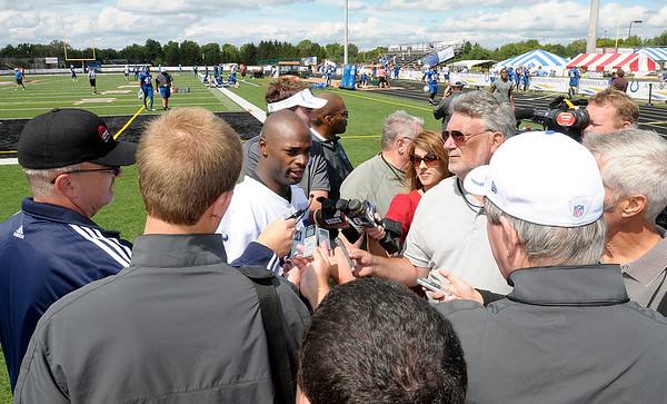 Wide receiver Reggie Wayne speaks to the media on Friday.