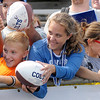 Ashley Andrews of North Webster waits for quarterback Andrew Luck to sign her football after the Colts' afternoon practice at Tire Barn Field on Friday.