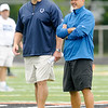 Colts General Manager Ryan Grigson and Head Coach Chuck Pagano talk during the Colts' afternoon practice at Tire Barn Field on Friday.