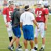 Quarterbacks coach Clyde Christensen talks to quarterbacks Drew Stanton and Andrew Luck.