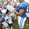 Dwight Freeney signs autographs.