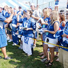 Laura Walkup of Murphysboro, Ill. high-fives punter Pat McAfee as he signs autographs following Colts practice at AU on Wednesday.