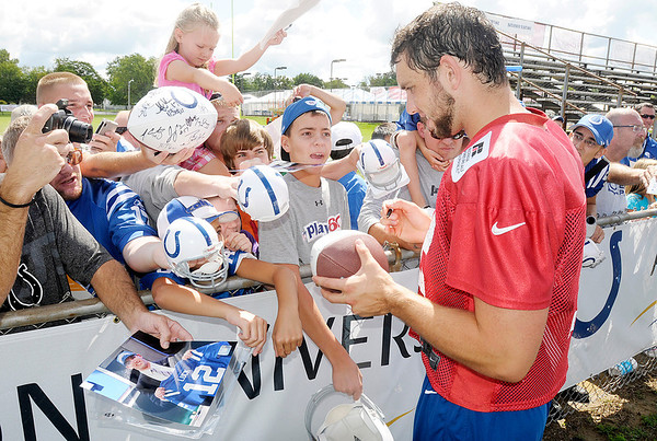 Andrew Luck signs autographs for fans as the Colts finished up camp at Anderson University on Friday.