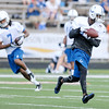 Reggie Wayne, right, and Kris Adams pull in passes as the Colts finished up camp at Anderson University on Friday.
