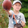 Don Knight/The Herald Bulletin<br /> A young fan asks Andrew Luck to autograph his football after the Colts practice at Anderson University on Wednesday.