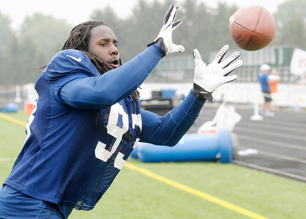 Don Knight/The Herald Bulletin<br /> Line backer Erik Walden runs through a catching drill after the Colts practice at Anderson University on Wednesday.