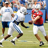 Quarterback Drew Stanton hands off to running back Vick Ballard during Colts camp on Saturday.