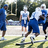 Tight ends Andre Smith (81) and Dominique Jones run through drills as tight ends coach Alfredo Roberts looks on during Colts camp on Tuesday.