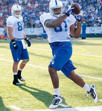 Andre Smith catches a pass during a drill at Colts camp on Tuesday.