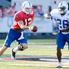 Andrew Luck hands off to Mewelde Moore during the first evening practice of Colts Camp on Tuesday.